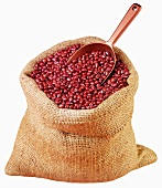 Azuki beans in jute sack with scoop