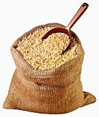 Kritharaki (Greek rice-shaped pasta) in jute sack with scoop