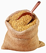 Fenugreek seeds in jute sack with scoop