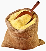 Cornmeal in jute sack with scoop