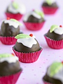 Small chocolate-coated Christmas puddings