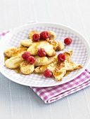 Star- and flower-shaped pancakes with raspberries