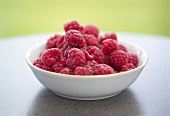 Fresh raspberries in small white dish