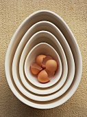Brown eggshells in nested dishes