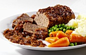 Meatloaf with carrots, peas and mashed potato
