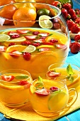 Punch with citrus fruit and berries in glass cups