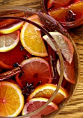 Mulled wine in punch bowl and glass cup