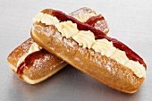 Finger doughnuts filled with vanilla cream and berry jam