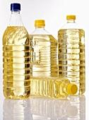 Vegetable oil in four plastic bottles