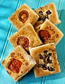 Focacce variopinte (Focaccia squares with tomatoes, olives, peppers)
