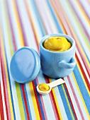 English mustard in a mustard pot