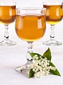 Three glasses of elderflower wine