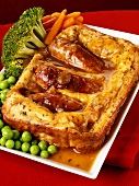 Toad-in-the-hole with vegetables and gravy