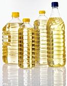 Corn oil in four plastic bottles