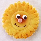Biscuit in shape of sunflower with face