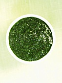A small dish of mint sauce