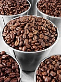 Roasted coffee beans in buckets
