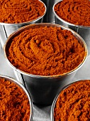 Paprika powder in buckets