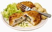 Chicken Cordon Bleu with herbs, garlic and potatoes