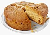Caramel cake, a piece cut, with cake slice