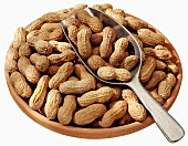Peanuts in a terracotta dish with scoop