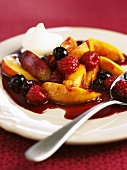 Mixed fruit with caramel sauce and whipped cream