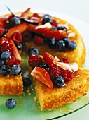 Polenta cake topped with fresh berries