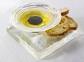 Olive oil & balsamic vinegar in a glass dish with salt, bread