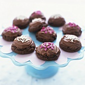 Chocolate biscuits with chocolate icing and sprinkles