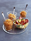 Fruit salad and herbal liqueur granita in three glasses