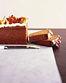 Spiced ginger cake with caramel shards, partly sliced