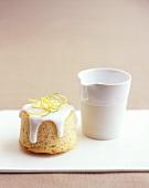 Small iced lemon cake with a small jug