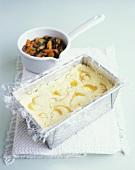 Lemon curd ice cream parfait mixture in a loaf tin