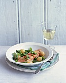 Braised salmon with onions, sugar snap peas and peas