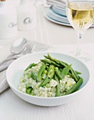 Risotto with green vegetables: asparagus, peas, beans