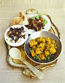 Cauliflower and peas with cumin, chicken, aubergine raita