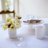 Tableware, napkins and spring flowers on table