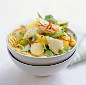 Asian noodle soup with fish and potatoes