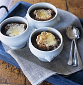 French onion soup in three bowls (seen from above)