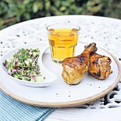 Chicken legs with cucumber salad out of doors