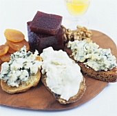 Various cheeses on toast with walnuts, apricots & port jelly
