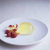 Nectarine jelly with fresh nectarine slices and raspberries