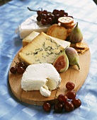 Cheese board with grapes, figs and crackers