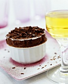 A chocolate soufflé with dessert wine
