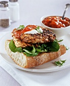 Barbecued chicken breast and tomato chutney on white bread