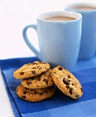 Chocolate chip cookies with two mugs of coffee