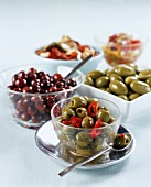 Various types of olives in dishes