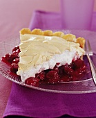 A piece of cherry tart with meringue