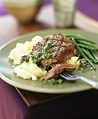 Grilled steak with pesto, beans and mashed potatoes