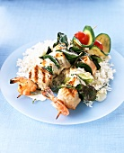 Grilled fish and vegetable kebabs on a bed of rice